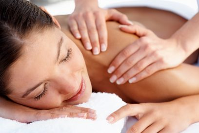 Young female getting a body massage at the day spa